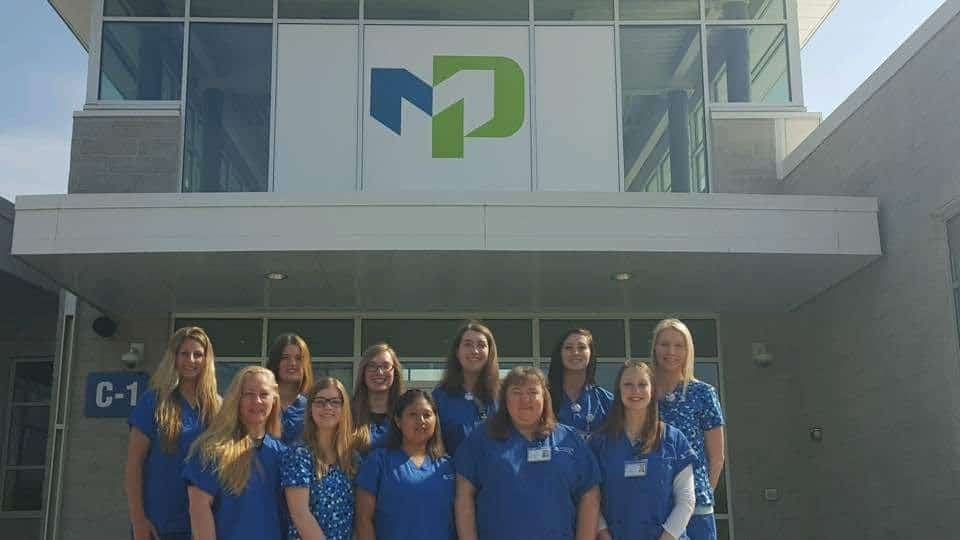group photo of moraine park radiography students on front steps of fond du lac campus