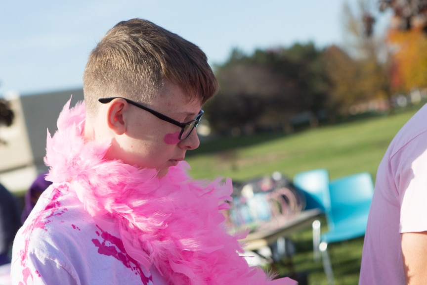 boy has pink costume on for breast cancer race