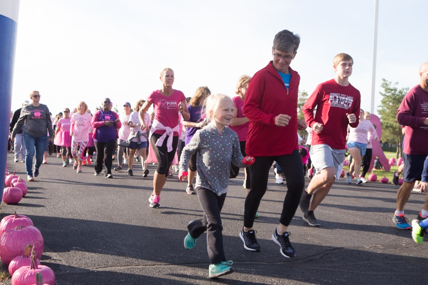 runners of all ages take part in moraine park pink pumpkin race