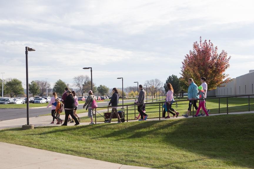 group walks down ramp pulling wagon