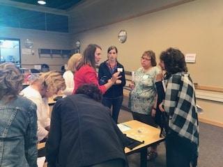 Dean Kristen Finnel talks with healthcare faculty