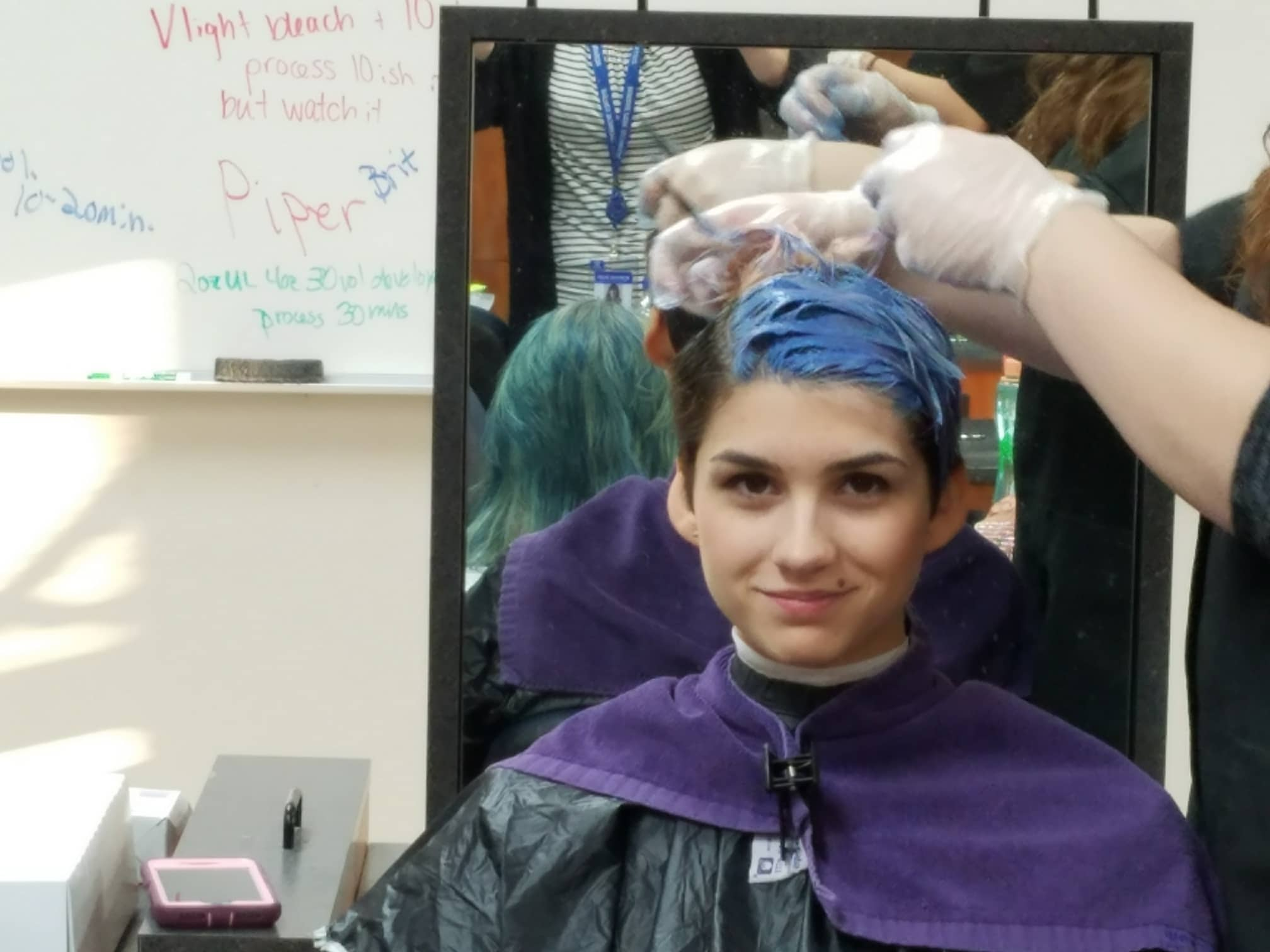 MPTC Cosmo students applying color to other students