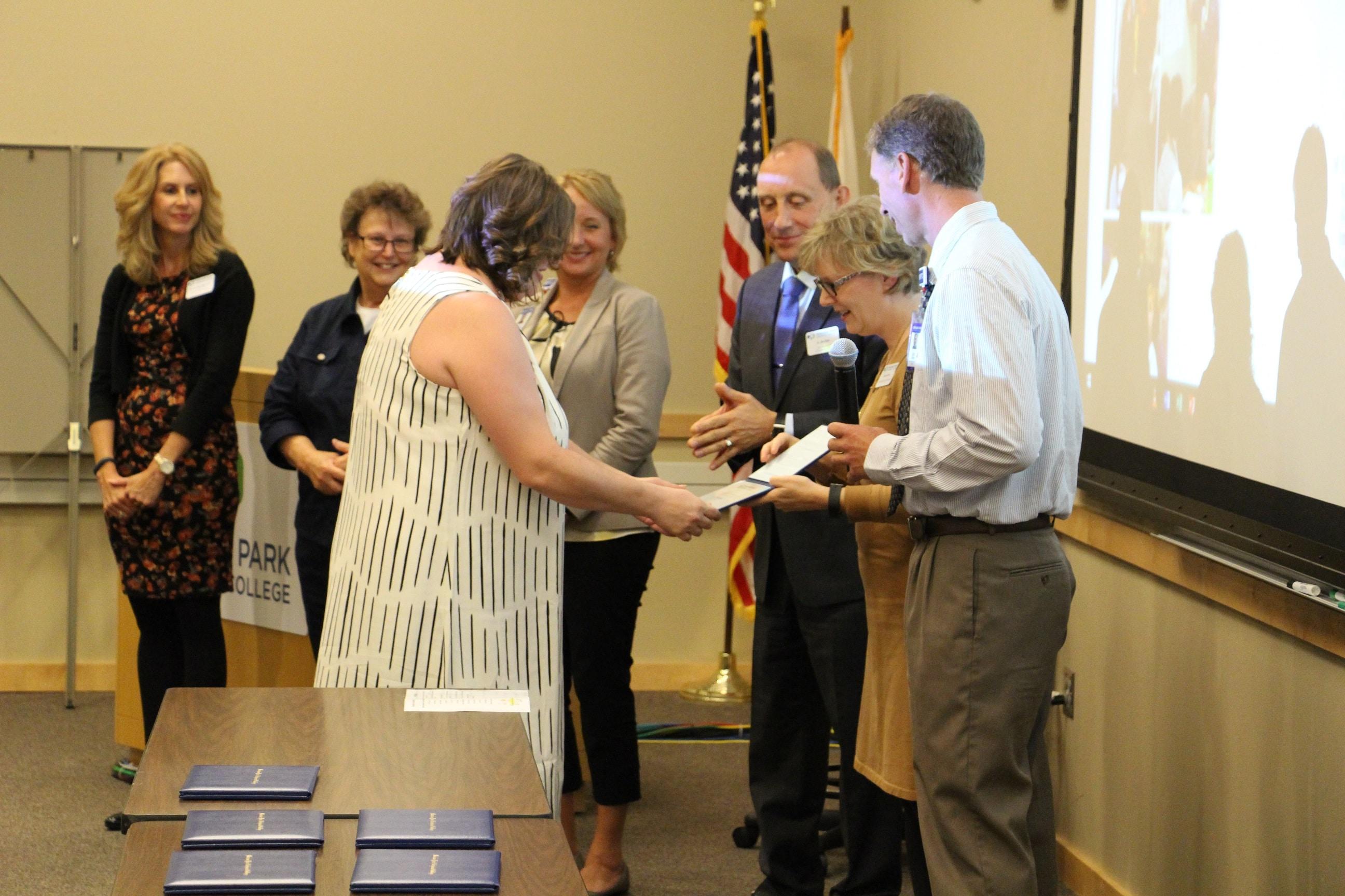 MA graduates receive diplomas