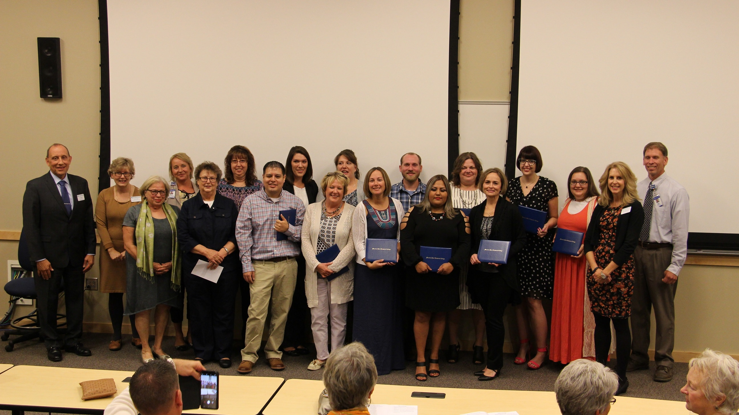 MA graduates celebrate with MPTC faculty and staff