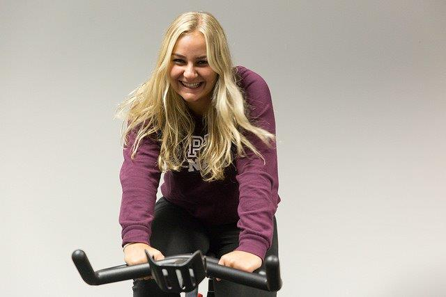 Young woman on an exercise bike