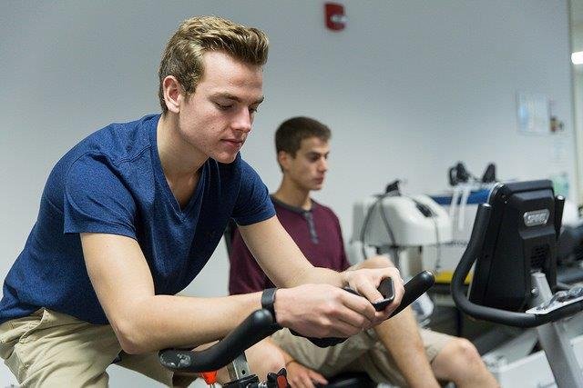 Young man on an exercise bike