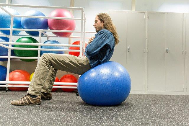 Young man on an exercise ball