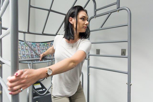 Woman using a stretch machine