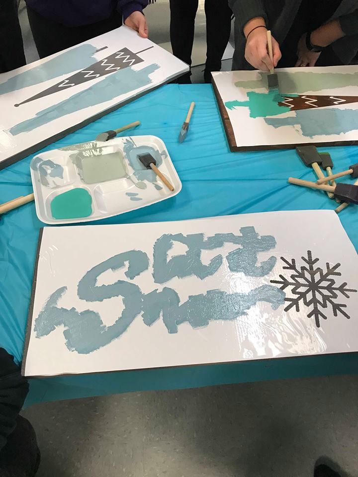 Painting progress picture of sign that says, Let it snow.