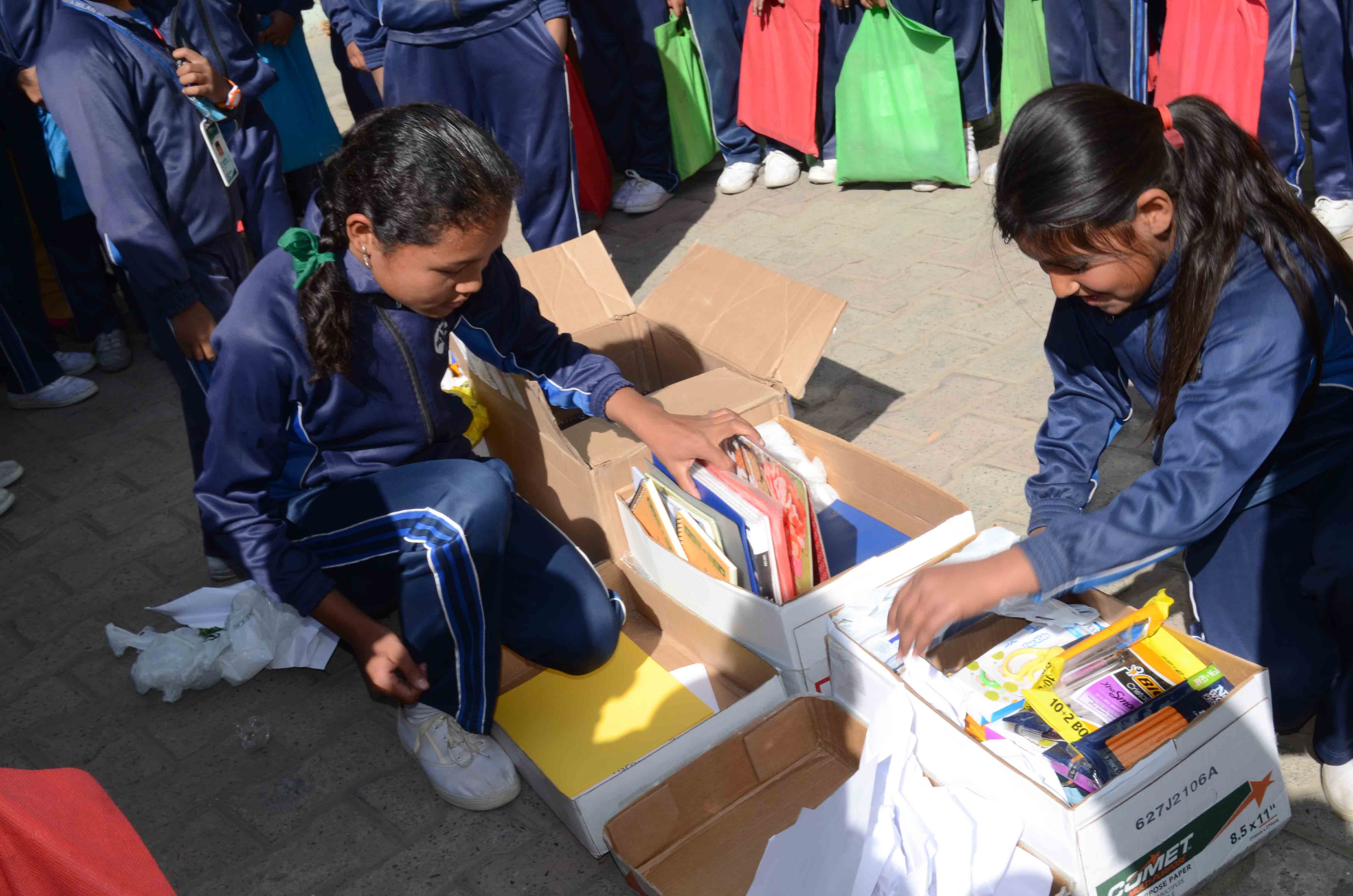 Nepal students open boxes of school supplies