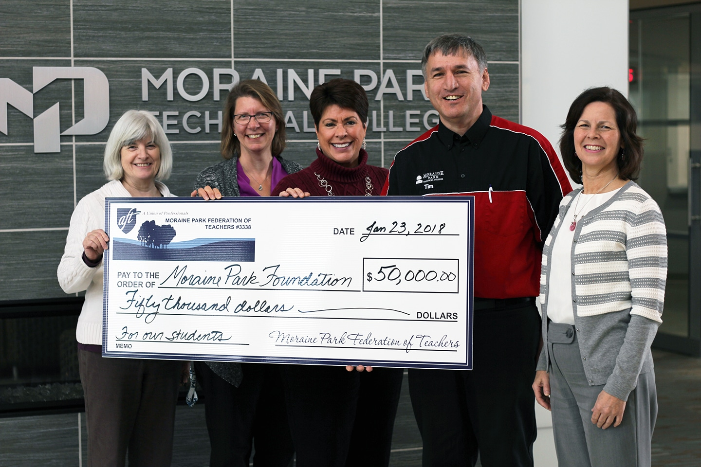 Picture of Moraine Park Foundation Director accepting $50,000 check from Moraine Park Federation of Teachers.