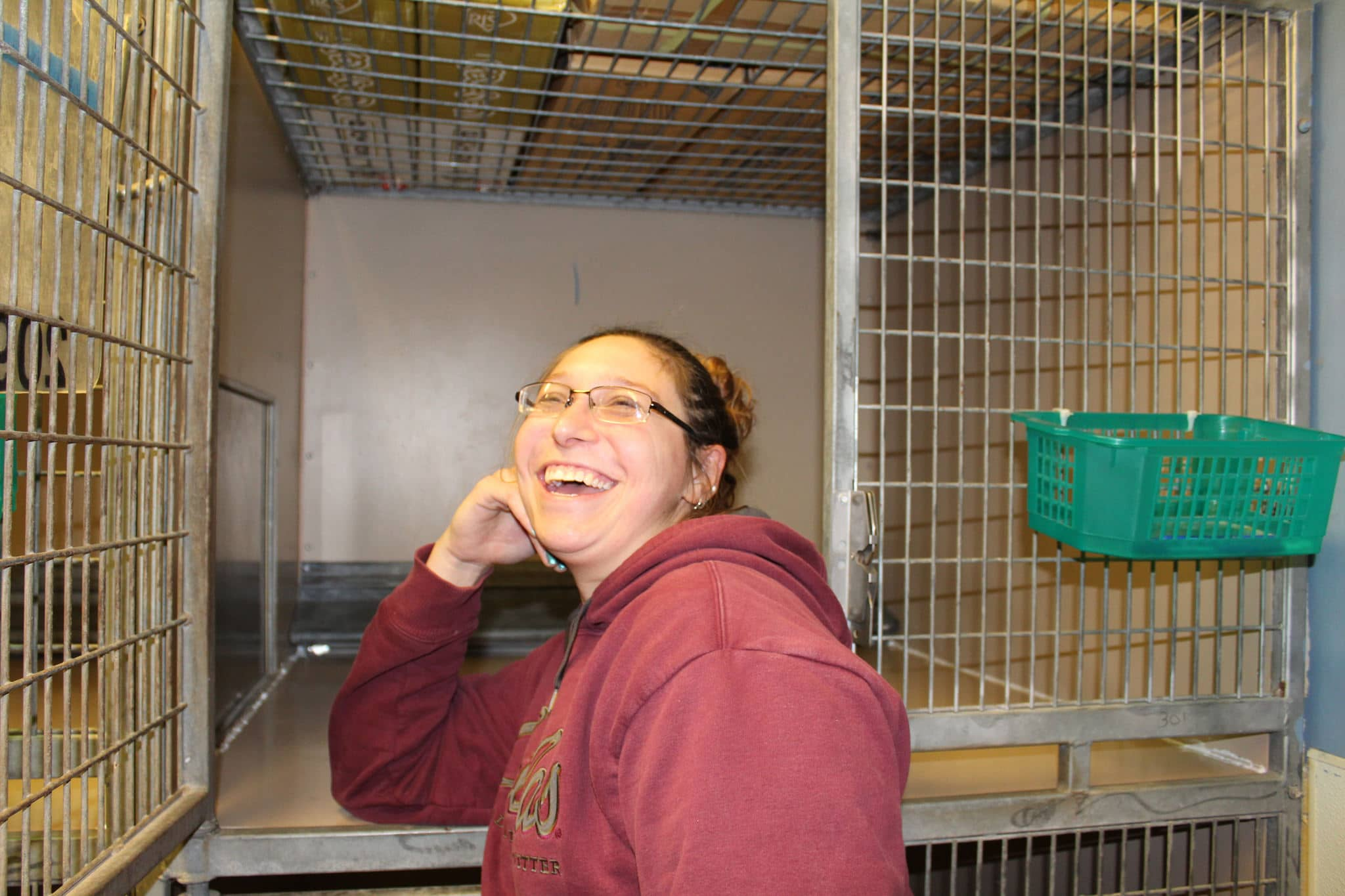 image of woman standing in front of a kennel