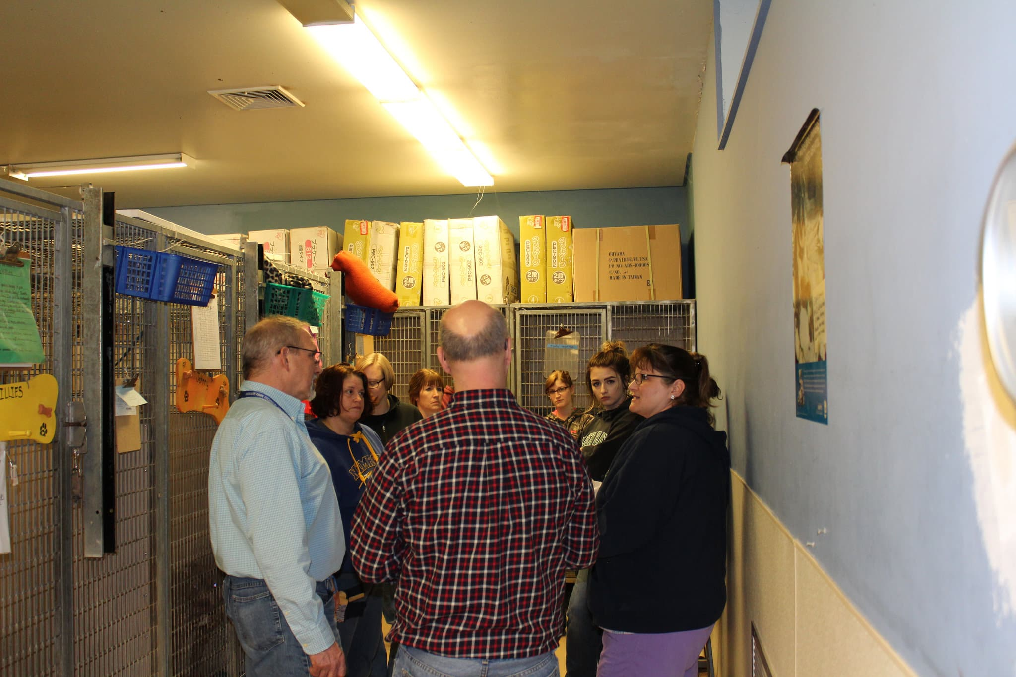 group talks in hallway of humane society