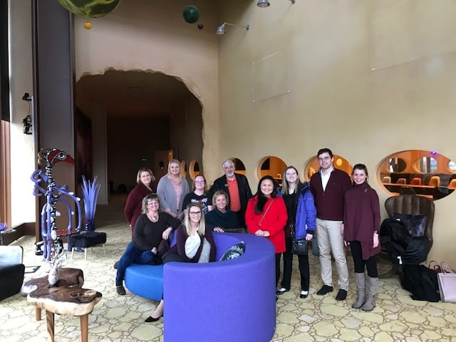 The student and faculty tour group gather in one of Epic's themed conference rooms.