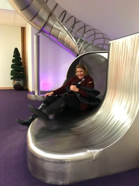 janet Bauer going down slide