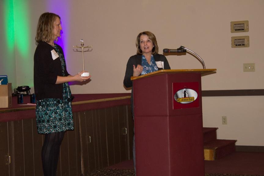 Bonnie Bauer presents the Administrative award to Michelle Duran