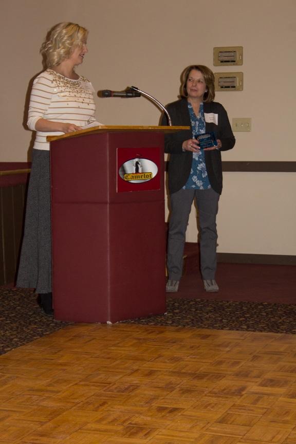 President Marla Werner presents award to Bonnie Bauer