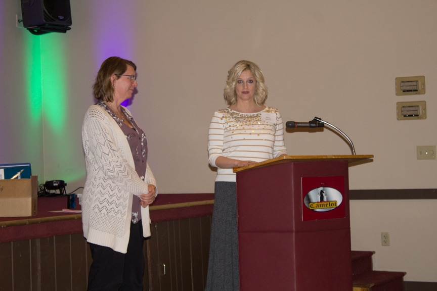 President Marla Werner presents award to Barb Brown