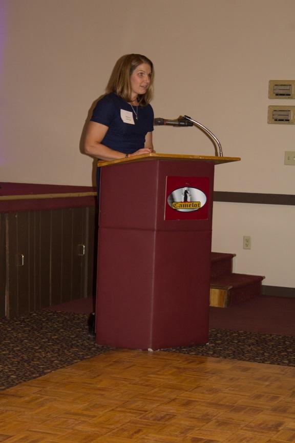 Melissa Schmitz accepts her award