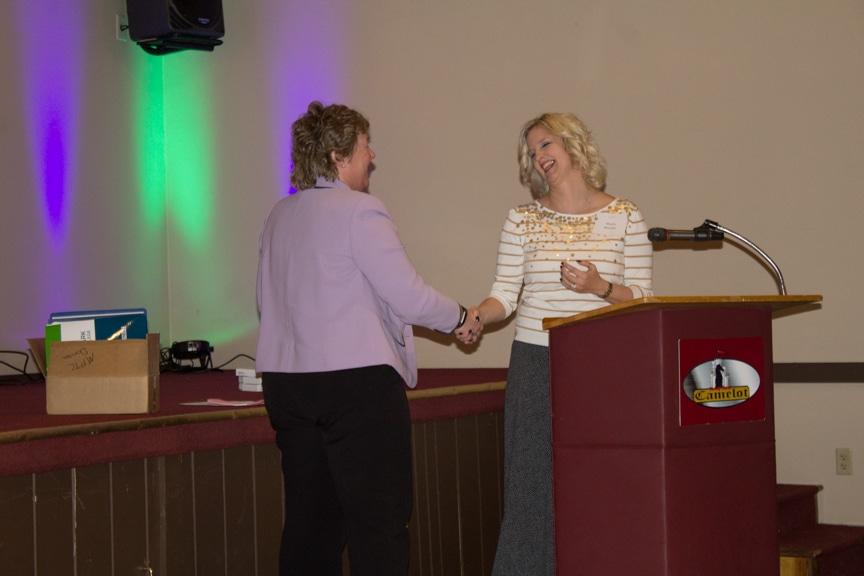 Marla presents award to President Bonnie Baerwald