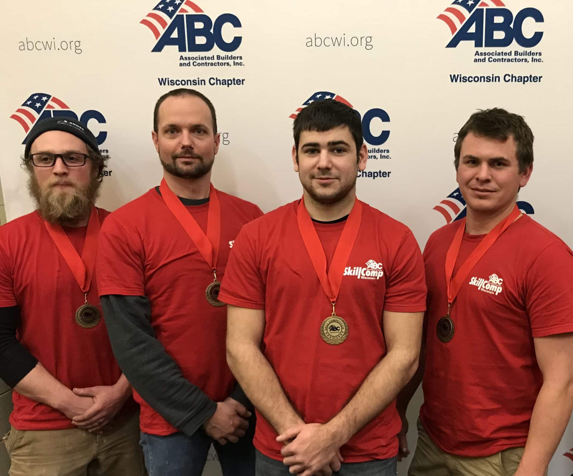 skill competition winners standing with medals around their necks