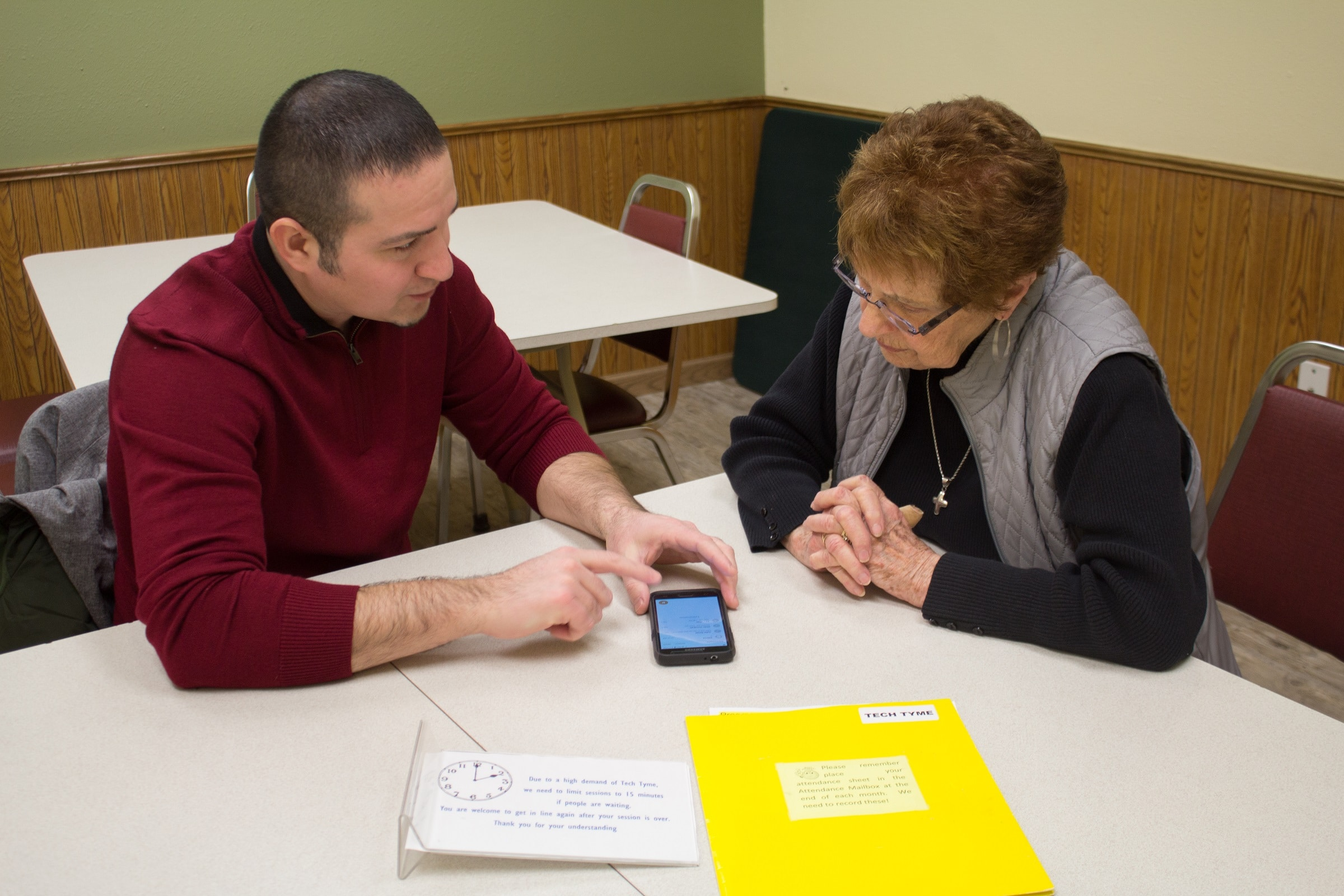 Jose helps senior with cell phone