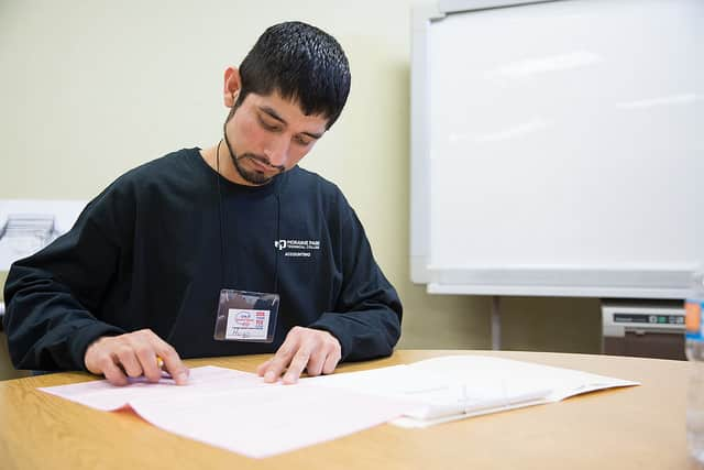 Male student working on accounting classwork.