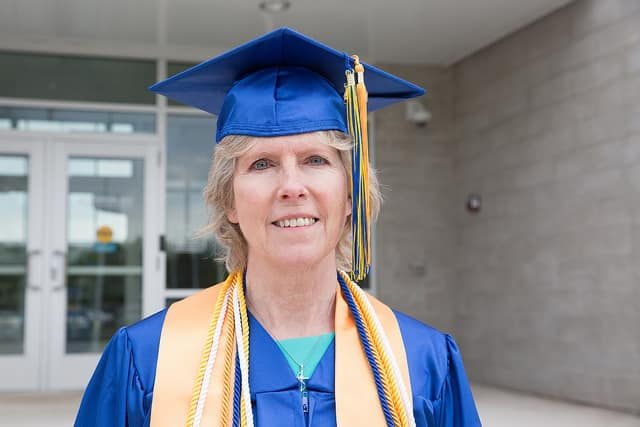 Women at graduation wearing high honor neck scarf.