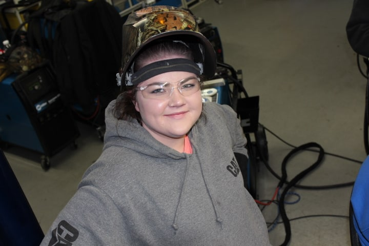 Female welding student