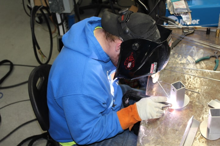 Welding student practicing welding skills.