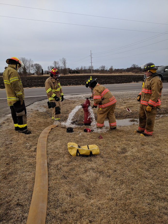 Firefighter students test fire hydrant skills.