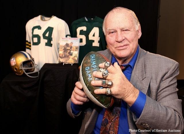 Green Bay Packer Jerry Kramer holding football.