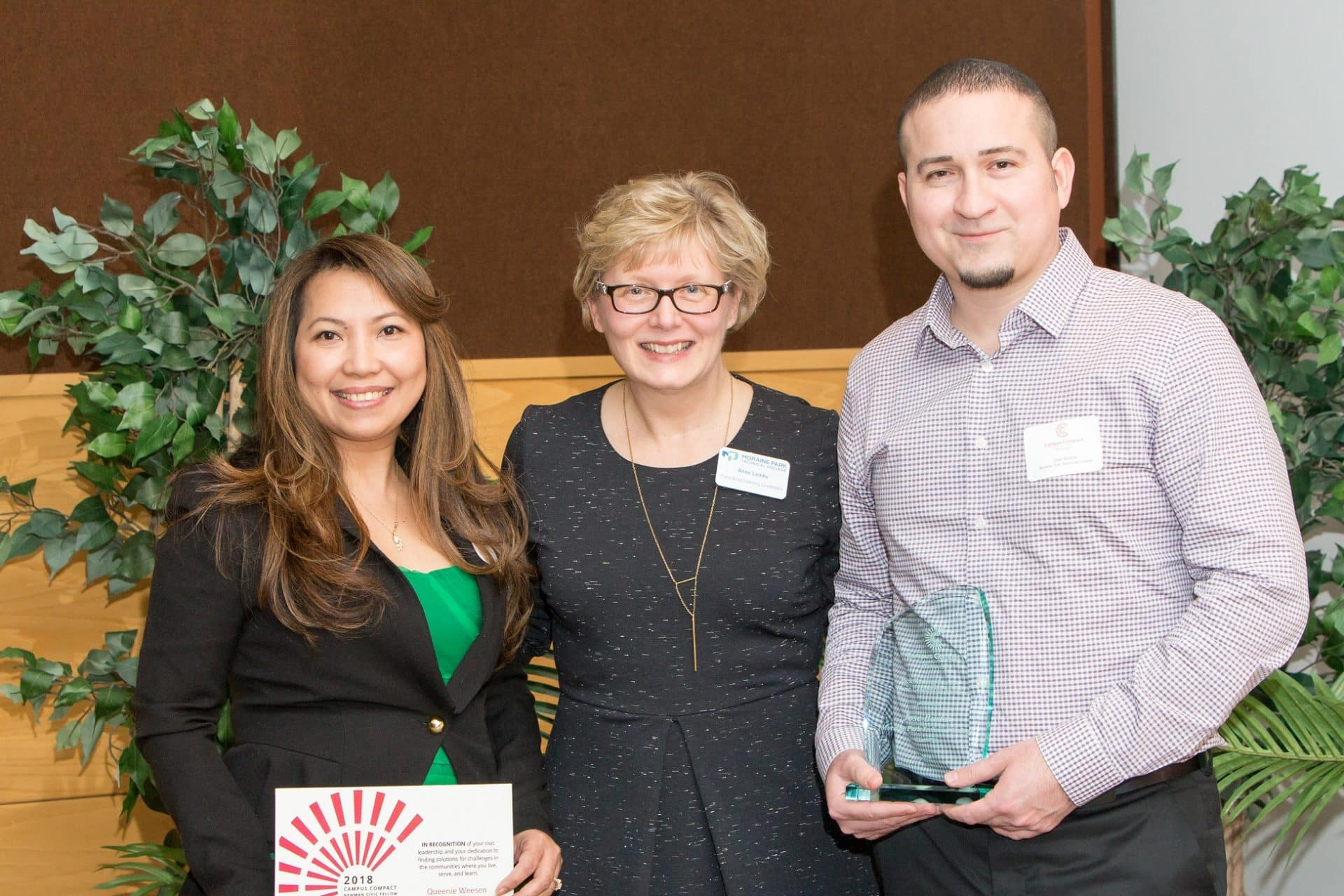 Queenie Weesen, Anne Lemke and Jose Bustos at Campus Compact awards