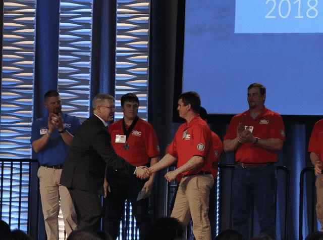 Jacob Moody accepting national award.