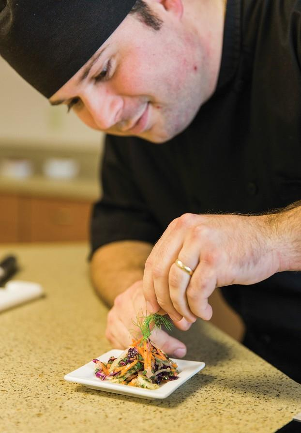Mike Wetzel putting finishing touches on a culinary dish