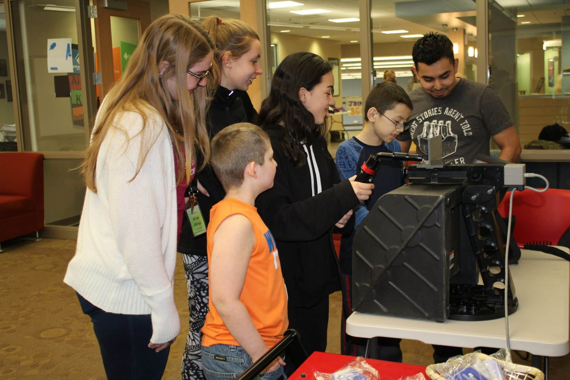 Nick Martinez show a group how to use the virtual welder at Boys and Girls Club