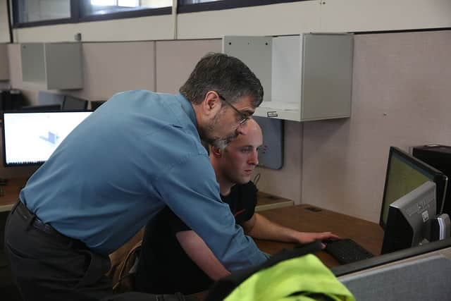 Jeff instructing student on computer.