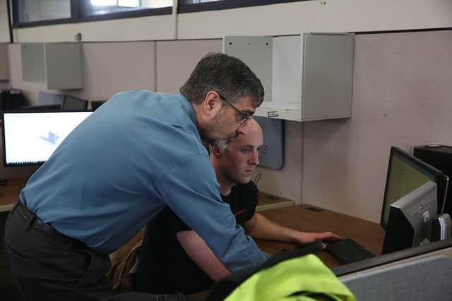 Jeff instructing student on computer.