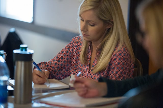 Woman taking notes.