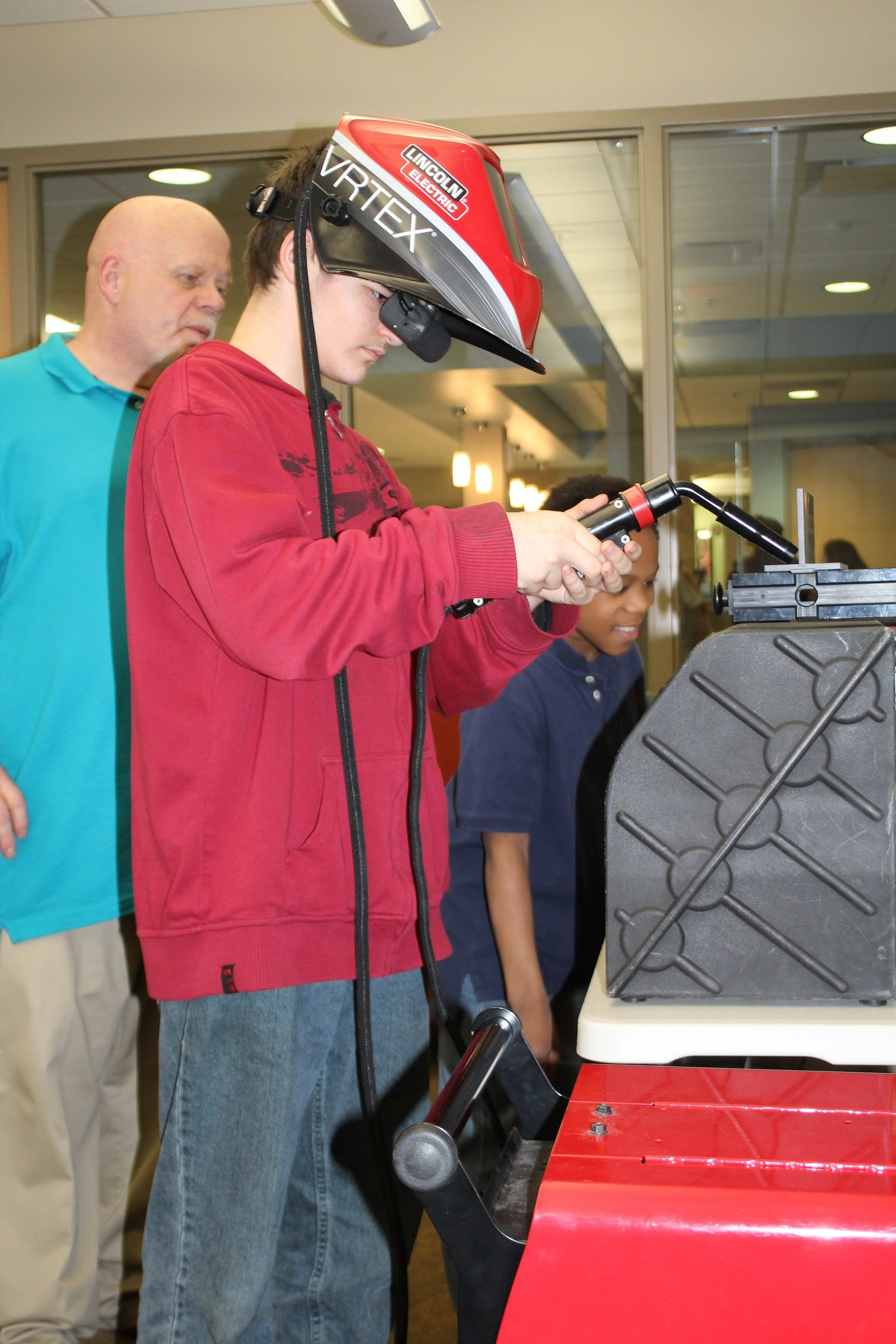 Young man tests the virtual welder at Boys and Girls Club