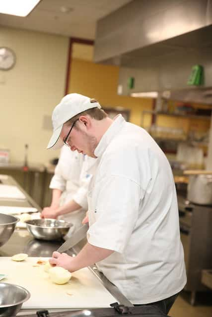 culinary student chopping onions