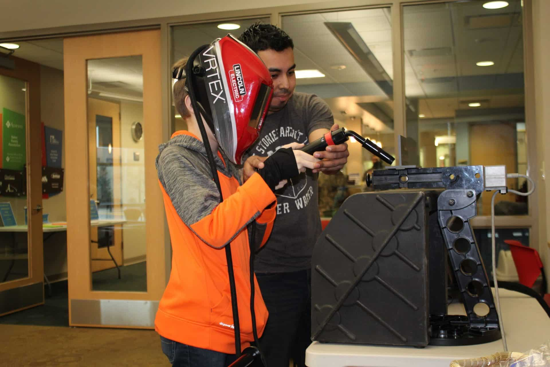 Nick Martinez demonstrates how to use the virtual welder at Boys and Girls Club