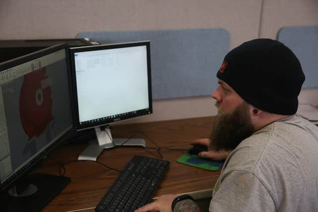 Mechanical design student works on computer