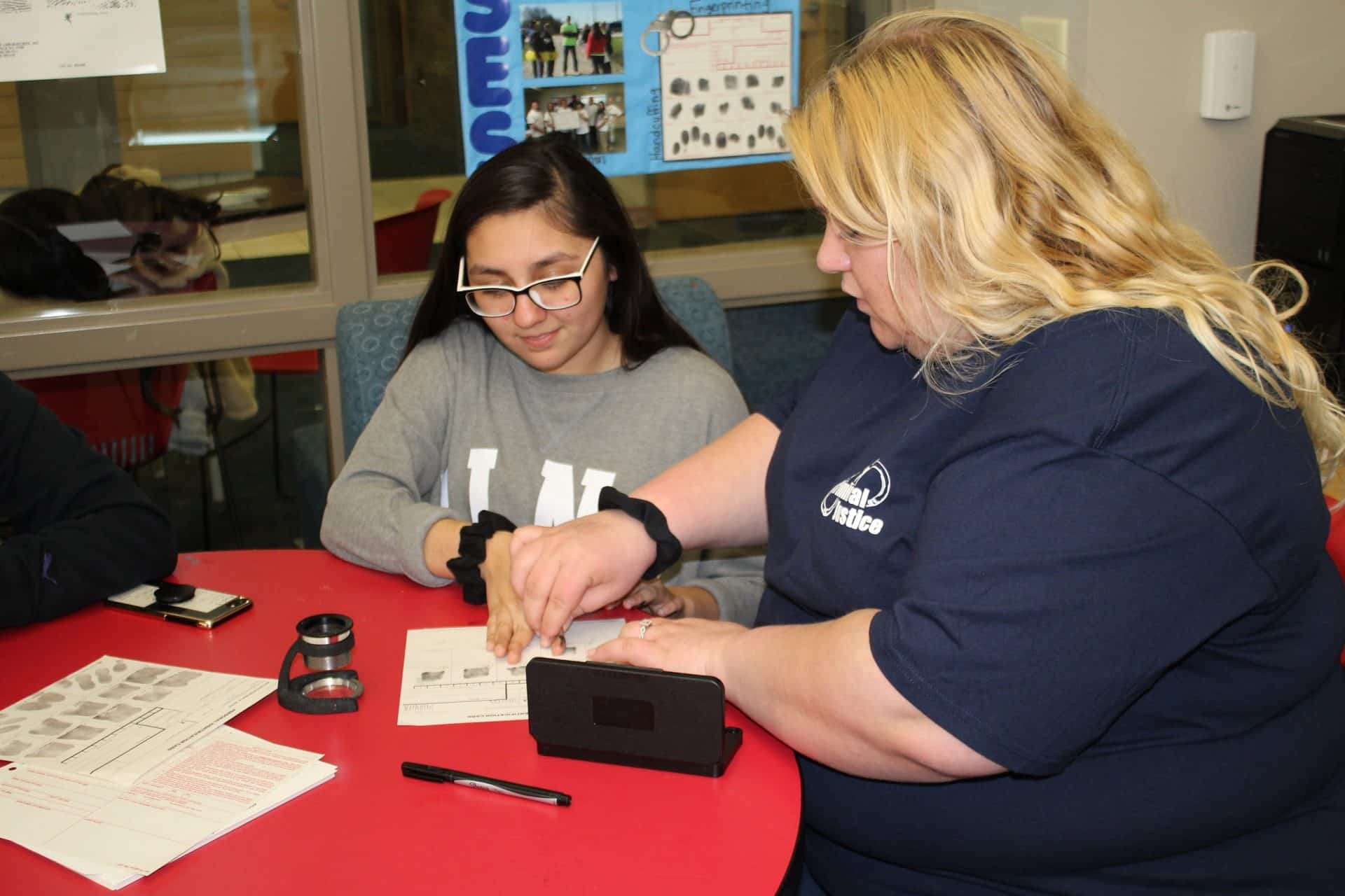 Boys and Girls club student participating in fingerprint exercise.