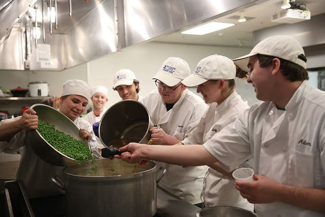 Culinary students making soup