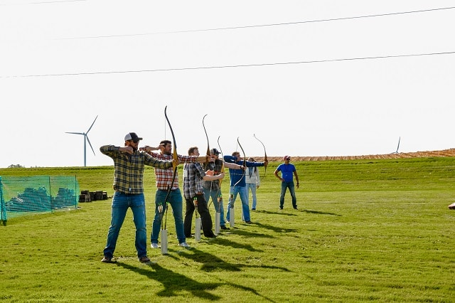 Men participating in archery for Man of the Ledge.