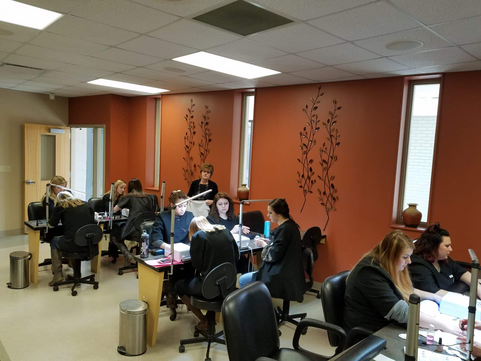 Cosmetology students learning nail procedures