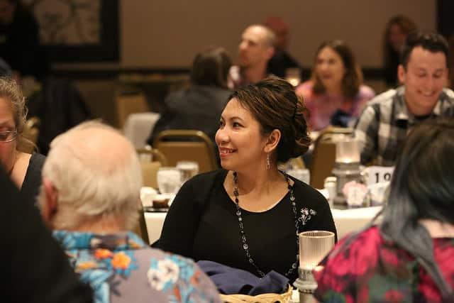 Woman posing at table.