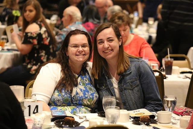 Two girls posing at awards banquet