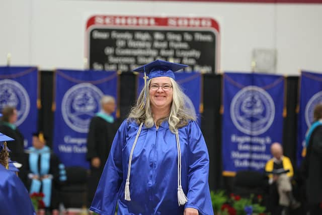 Female in graduation gown smiling